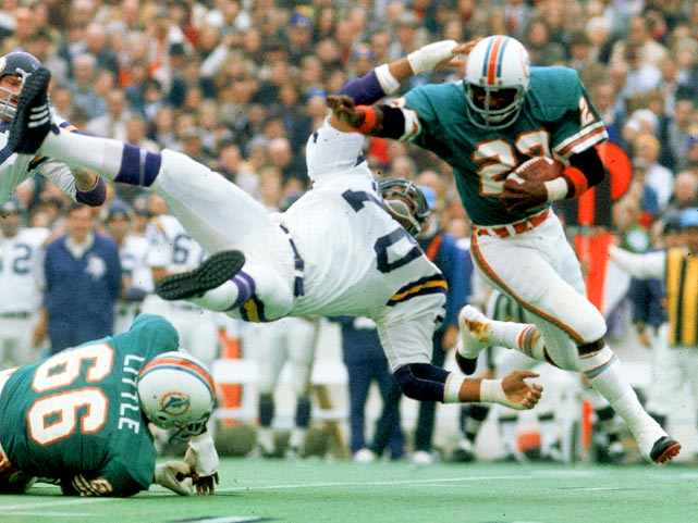 Miami Dolphins running back Mercury Morris breaks a tackle on a carry to the outside. Morris provided the latter part of the 1-2 punch of Miami's running game in the 24-17 win over Minnesota, spelling Csonka for 11 carries for 34 yards.