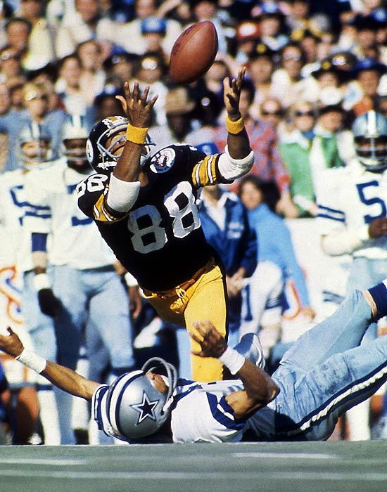 Lynn Swann makes a diving catch over the Dallas Cowboys' Mark Washington. The Steelers wide receiver was named Super Bowl MVP after catching four balls for 161 yards and a touchdown in Pittsburgh's 21-17 win over the Cowboys.
