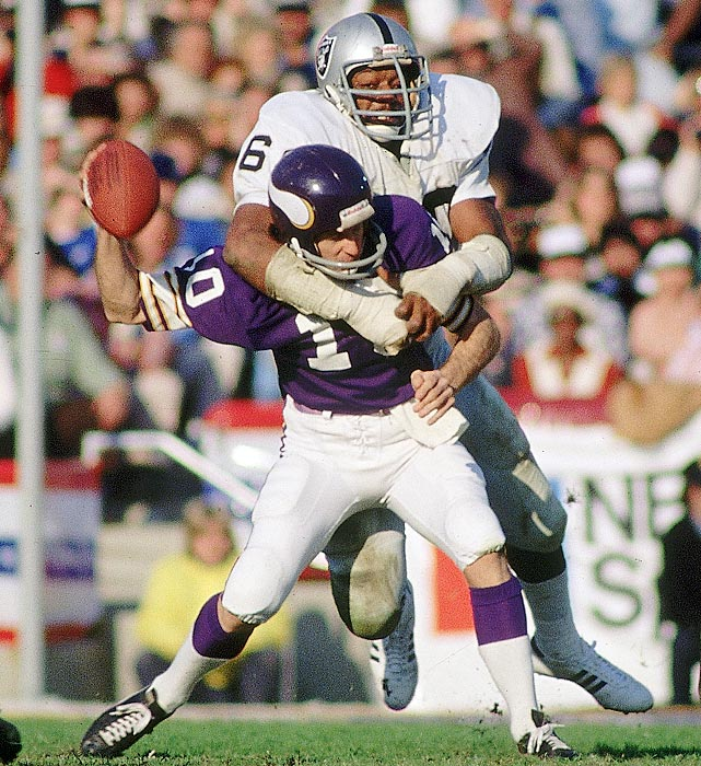 Oakland Raiders defensive end Otis Sistrunk sacks Fran Tarkenton, forcing the Minnesota Vikings quarterback to fumble. Oakland's offense had a field day with the Vikings, setting a Super Bowl record with 429 yards of offense in the 32-14 win.