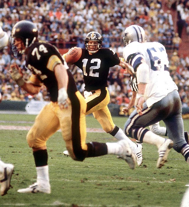 Pittsburgh Steelers quarterback Terry Bradshaw scrambles away from the Dallas Cowboys defense before tossing a touchdown pass to Rocky Bleier. Led by Bradshaw's 318 passing yards and four touchdowns, the Steelers won in a shootout, beating the Cowboys 35-31. Dallas is the only team to score 30 or more points and lose a Super Bowl.