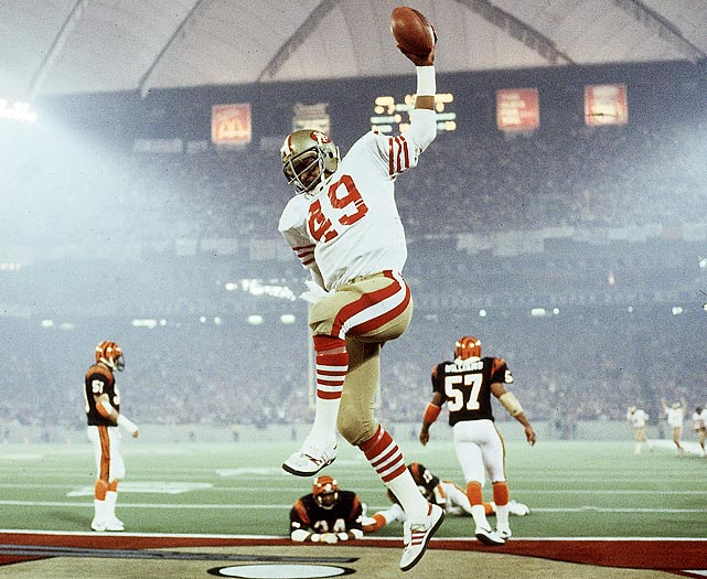 Fullback Earl Cooper celebrates after scoring a 10-yard receiving touchdown in the second quarter while Cincinnati Bengals cornerback Lewis Breeden looks on from the ground. Cooper's touchdown gave the San Francisco 49ers a 14-0 lead as they went on to win 26-21.