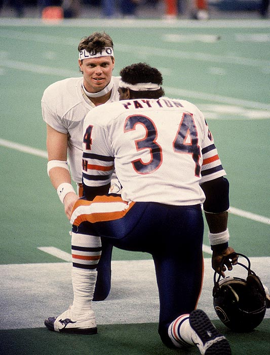 Legendary running back Walter Payton chats on the sidelines with quarterback Jim McMahon. In the only Super Bowl of Payton's Hall of Fame career, he was held to 61 yards on 22 carries with a fumble. Very little went right for the New England Patriots other than limiting Payton as the Chicago Bears routed New England 46-10.