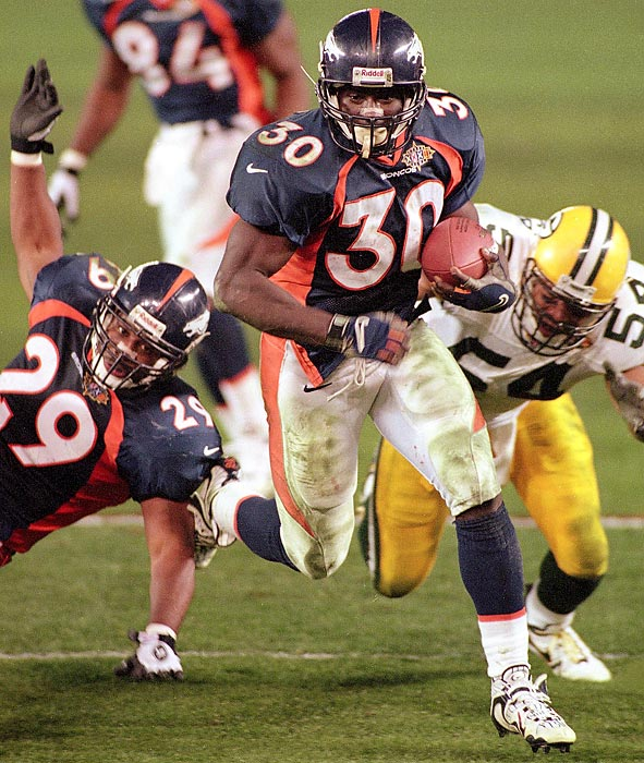Denver Broncos running back Terrell Davis rushes past Green Bay Packers linebacker Seth Joyner. Davis missed most of the second quarter with a migraine but still rushed for 157 yards with three touchdowns to earn Super Bowl MVP in Denver's 31-24 victory..