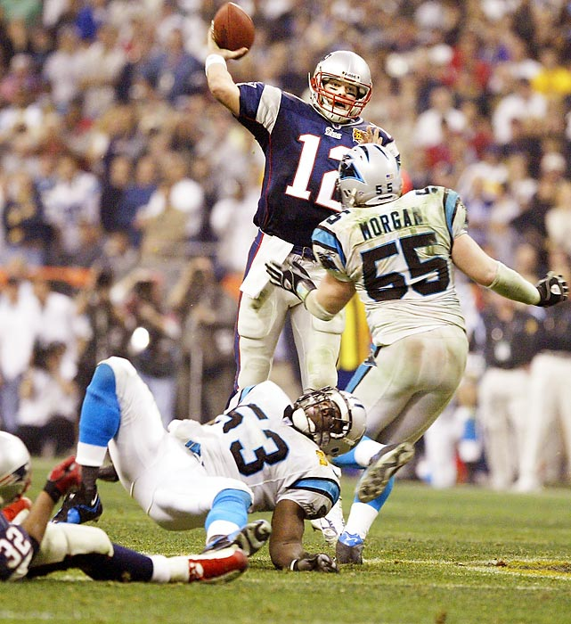New England Patriots quarterback Tom Brady throws a pass as Carolina Panthers linebacker Dan Morgan advances toward him. Brady was named Super Bowl MVP after completing 32 of 48 passes for 354 yards and three touchdowns in the 32-29 win.