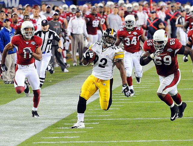 Linebacker James Harrison beats the Arizona Cardinals in a foot race as he returns a Kurt Warner interception 100 yards for a touchdown. Harrison's interception return, which came on the last play of the second quarter, is the longest play in Super Bowl history and gave the Pittsburgh Steelers a 17-7 halftime lead.