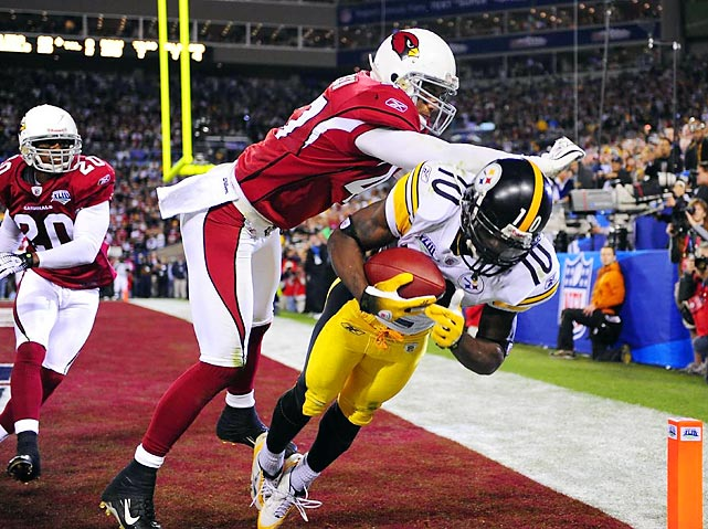 Pittsburgh Steelers wide receiver Santonio Holmes gets both feet down in the back right corner of the end zone to score a game-winning touchdown as safety Aaron Francisco attempts to push him out of bounds. After Arizona had scored 16 consecutive points in the second half to take a 23-20 lead, Holmes pulled in this Ben Roethlisberger pass with 35 seconds left to lift the Steelers to the 27-23 win.
