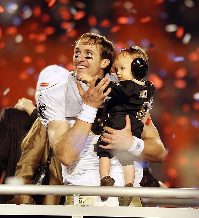 New Orleans Saints quarterback Drew Brees holds his son Baylen after the Saints' 31-17 win over the Indianapolis Colts. The victory was the first Super Bowl title for New Orleans and came just four years after Hurricane Katrina decimated the city and forced the Saints out of the Superdome for a year.