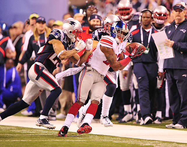 Wide receiver Mario Manningham barely gets both feet down in bounds on a 38-yard reception that set up the New York Giants' game-winner in a 21-17 game. Manningham caught five passes for 73 yards against the Patriots.