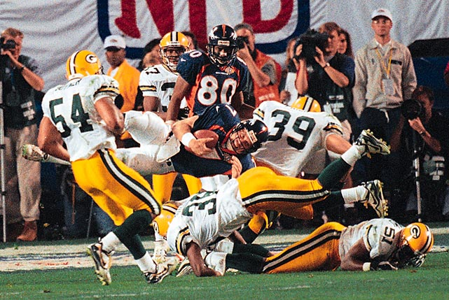 Denver Broncos quarterback John Elway gets helicoptered on a third-down hit by Green Bay Packers safeties LeRoy Butler and Mike Prior. Despite the big hit, Elway picked up a first down on the play, keeping Denver's drive alive for a later Terrell Davis touchdown. That touchdown drive proved crucial in the Broncos' hard-fought 31-24 win.