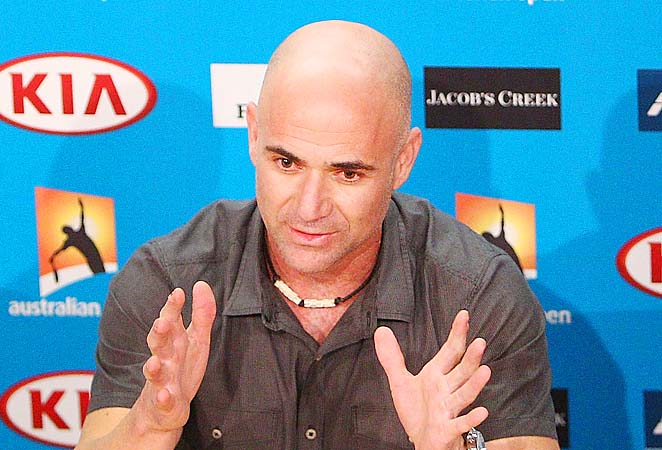 Andre Agassi will present the winner's trophy to Andy Murray or Novak Djokovic on Sunday.
