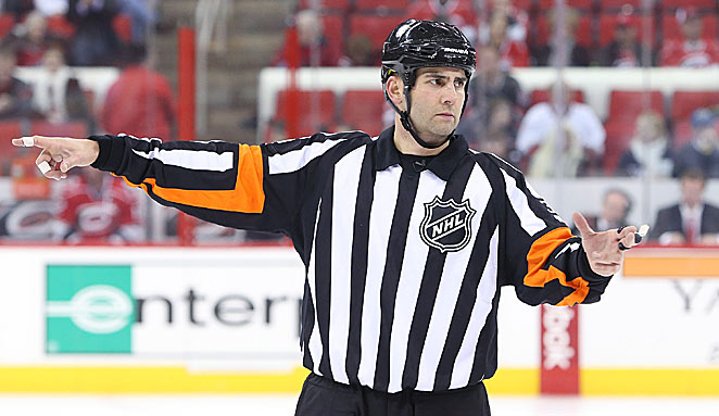 As their whistles try to set a tone, NHL officials are still getting up to speed after the long lockout.