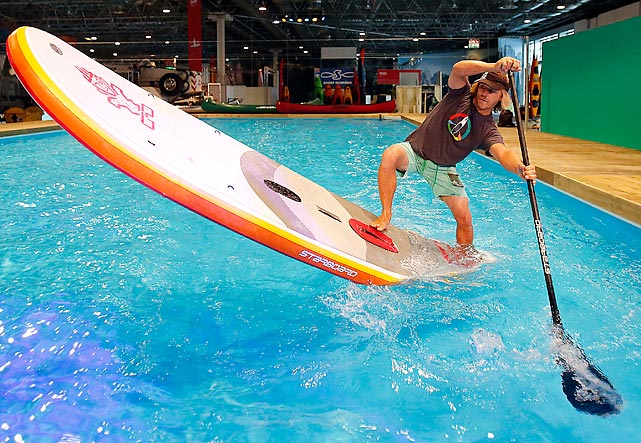 The German paddle champ tests the new Astro Tender, an inflatable SUP-Board at a preview for the International Boat fair in Duesseldorf. Looks like it would be warmly received at crowded public pools.