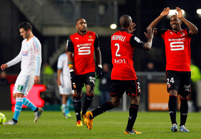 Rennes' Kevin Theophile-Catherine (center) celebrates with teammates after scoring against Marseille.