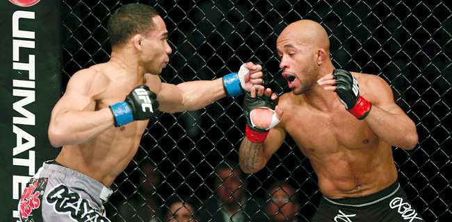 "Demetrious ""Mighty Mouse"" Johnson (right) took control in the fifth round to defend his flyweight title."