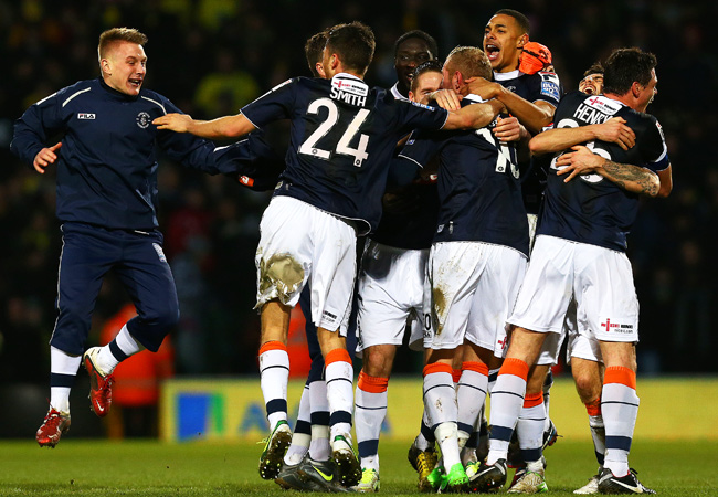 Luton players celebrate after pulling off a huge upset in the fourth round of the FA CUp.