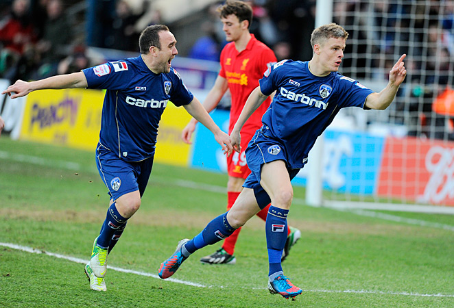 Matt Smith and third-tier Oldham stunned visiting Liverpool 3-2.