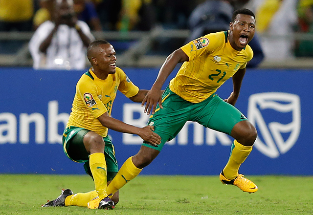 Siyabonga Sangweni (right) celebrates after scoring Sunday against Morocco.