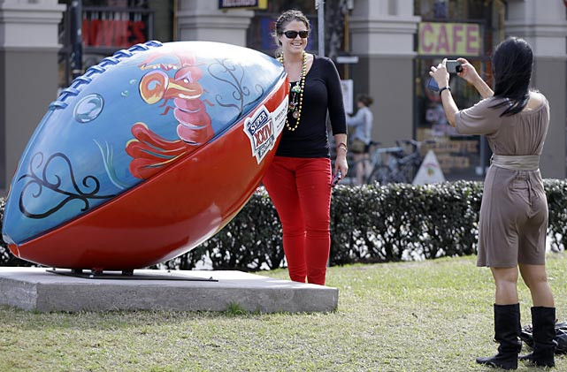 Kendall Williamson of St. Louis stands by a giant football and has her picture made by Heather Chau.