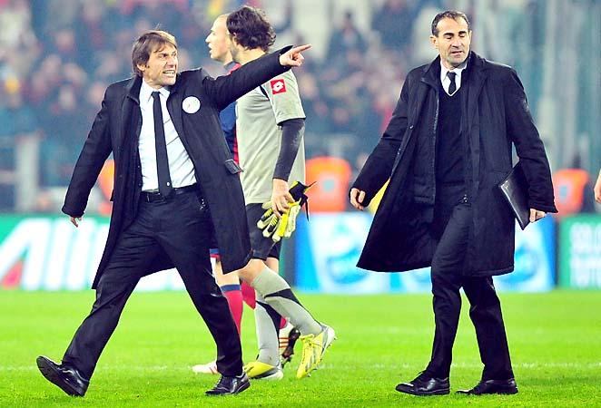 Juventus coach Antonio Conte reacts against referee Marco Giuda at Saturday's match.