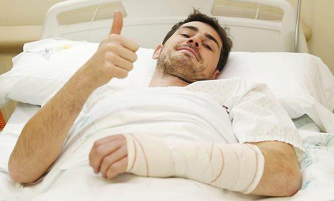 Iker Casillas of Real Madrid gives the thumbs up after undergoing surgery on his left hand.