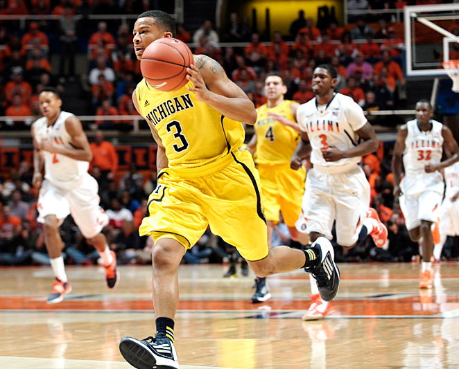 Guard Trey Burke and Michigan climbed to No. 1 in the AP Poll after beating Illinois 74-60 on Sunday.