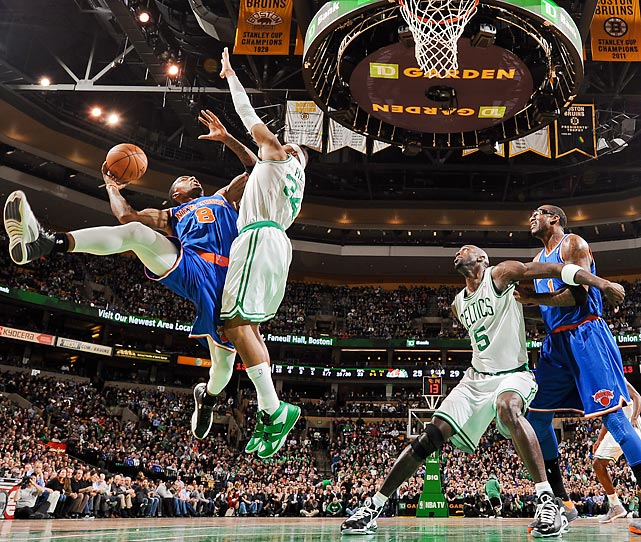 New York Knicks shooting guard J.R. Smith attempts a contested layup against Boston Celtics small forward Paul Pierce in a Jan. 24 game. Smith hit a big three-pointer with 1:11 remaining to put the Knicks up by five as they held on to win 89-86.