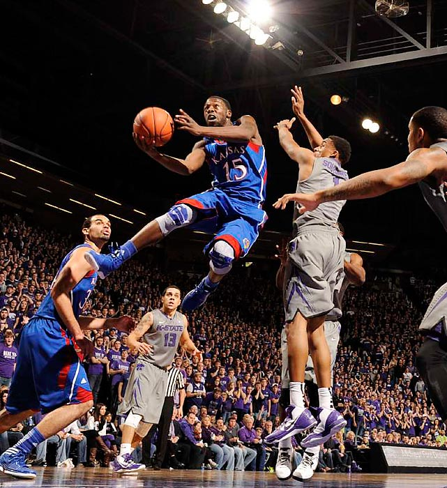 Kansas guard Elijah Johnson sneaks past Kansas State guard Shane Southwell for a layup in the first half of the in-state rivalry game. Johnson's Jayhawks earned state bragging rights, holding off the Wildcats 59-55.