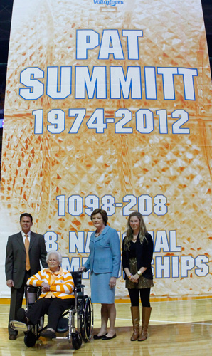 Pat Summitt poses in front of the banner with athletic director Dave Hart, her mother and future daughter-in-law.