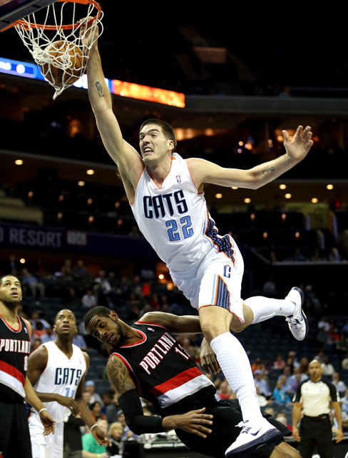 Bobcats center Byron Mullens only has eyes for the rim as he flattens Trail Blazers forward LaMarcus Aldridge, putting the slam in this dunk.