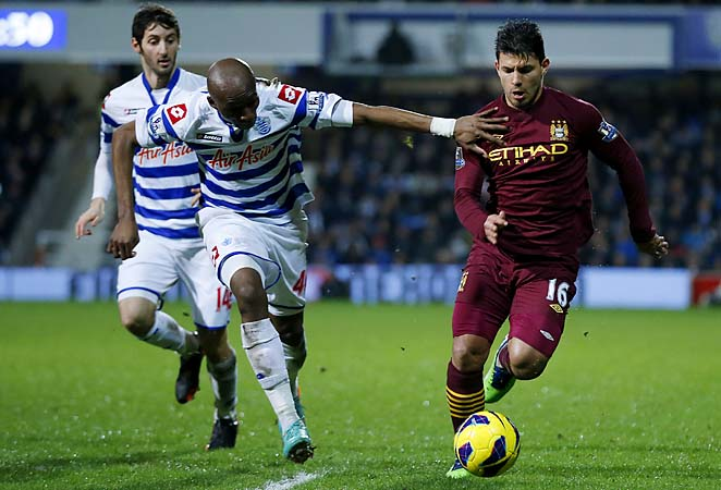 Manchester City's Sergio Aguero tried to dribble past QPR defenders in their match Tuesday.