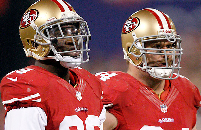 Aldon Smith (left) was the 49ers' 2011 first-round pick; Justin Smith went No. 4 overall to the Bengals in 2001.