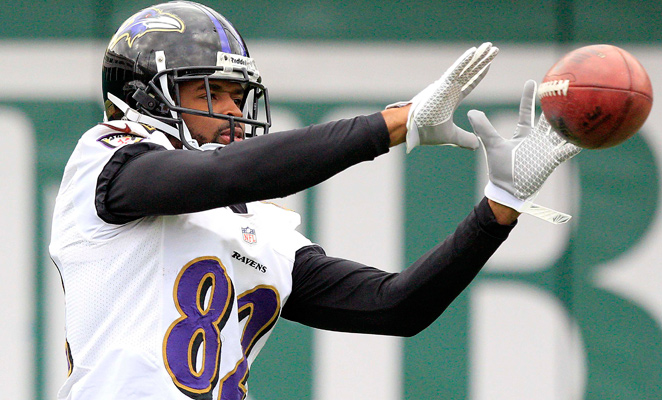 Torrey Smith catches a pass in warmups as the Ravens practice at Tulane on Wednesday.