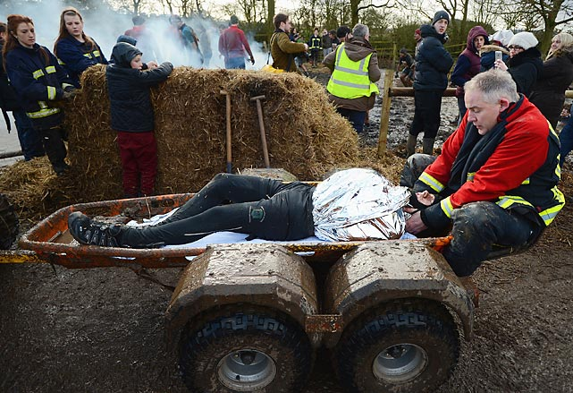 <italics>Bring out yer dead!</italics> (<bold>Here's the official video</bold>.) Another fallen competitor's carcass is hauled away during the big endurance race in Telford, England, where every year thousands of people insist on running the eight-mile course that features freezing temperatures, fire and ice.
