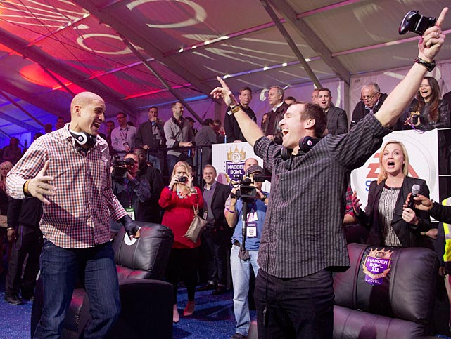New Orleans Saints quarterback Drew Brees and tight end Jimmy Graham celebrate a touchdown during the EA Sports Madden Bowl Friday.