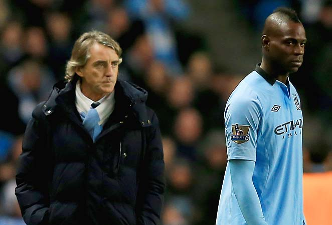 Roberto Mancini (left) and City face Manchester United on Monday.