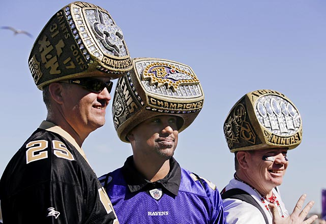 Rion Loisel of Metairie, La., Uland Price, of Baton Rouge, La., and Mark Castanon of San Jose, Calif., pose for a photo wearing their custom made Super Bowl ring hats.