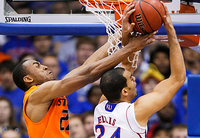 Markel Brown blocks the shot of Perry Ellis as OSU snapped Kansas' 18-game winning streak.