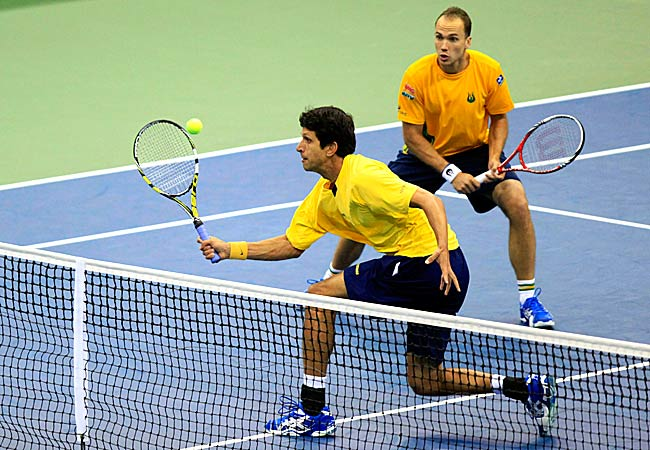 Marcelo Melo and Bruno Soares upset top-ranked Mike and Bob Bryan 7-6 (6), 6-7 (7), 6-4, 3-6, 6-3.