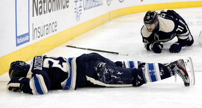 James Wisniewski lay face down on the ice for a few minutes after an awkward crash into the boards.