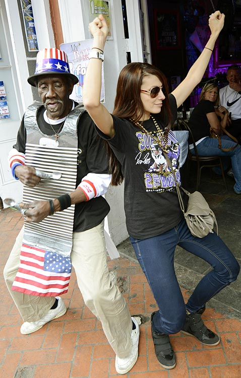 Super Bowl fans and locals party in the French Quarter.