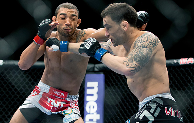 Jose Aldo (left) improved to 22-1 after stopping Frankie Edgar at UFC 156 in Las Vegas.