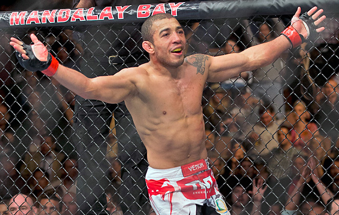 José Aldo celebrates his unanimous victory over Frankie Edgar in the main event of UFC 156.