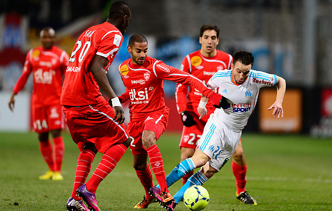 Mathieu Valbuena (right) and Marseille offense couldn't get the ball past the Nancy defense.