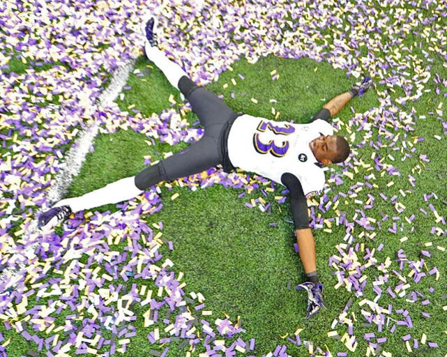 It wasn't quite the same as making a snow angel, but Chykie Brown took advantage of the confetti shower in the Superdome.