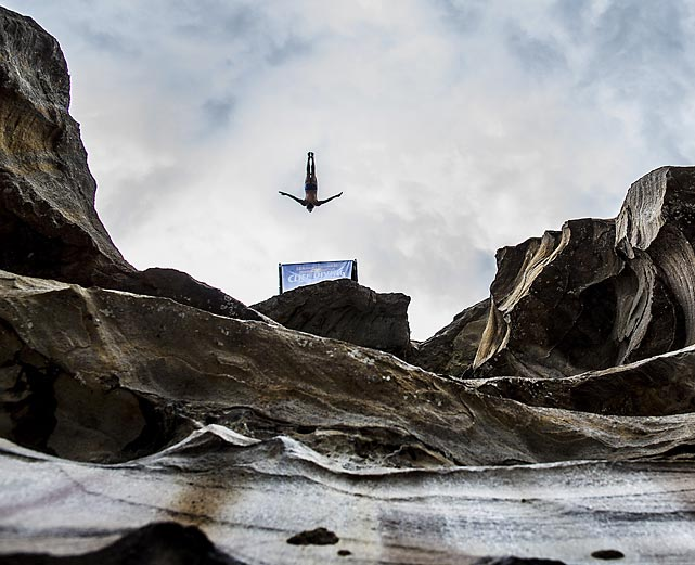 Cyrille Oumedjkane dives from the 26.5-meter platform on the Hawkesbury River in Sydney, Australia, during the qualification competition for the 2013 Red Bull Cliff Diving World Series. The Frenchman missed qualification by one spot as Matt Cowen claimed the fifth and final spot, 4.30 points ahead.
