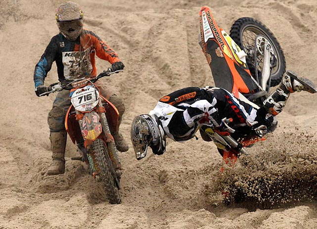 Austrian Michael Staufer falls off his bike during the Enduropale motorcycle endurance race in Le Touquet, France. About 1,000 motorbike and 500 quad bike racers compete in the beach race every year.