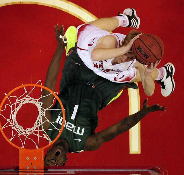 North Carolina State guard Tyler Lewis puts up a layup as Miami guard Durand Scott gets knocked backward in the Wolfpack's and Hurricanes' Feb. 2 matchup. Scott scored a game-high 18 points as No. 14 Miami barely topped No. 19 North Carolina State 79-78.