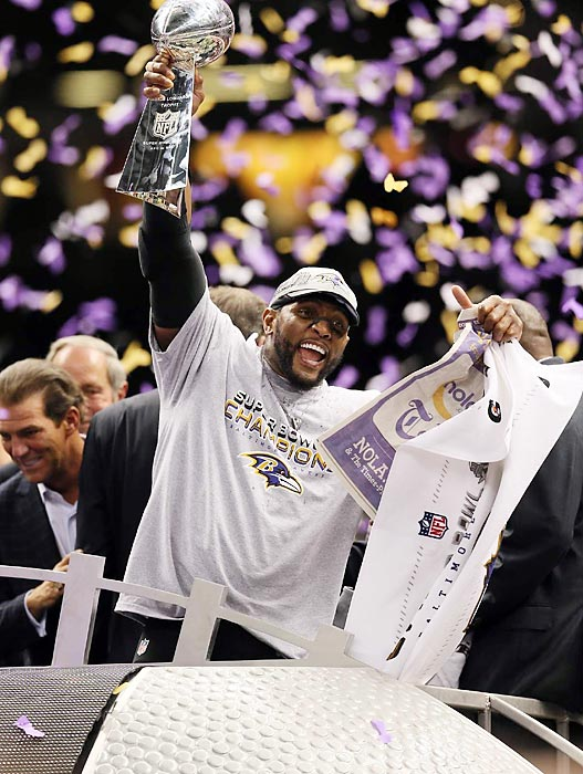 Ray Lewis hoists the Lombardi Trophy as he celebrates the Baltimore Ravens' Super Bowl XLVII win. The victory caps off a 17-year career for the star linebacker who announced before the playoffs that he would retire at the season's end.