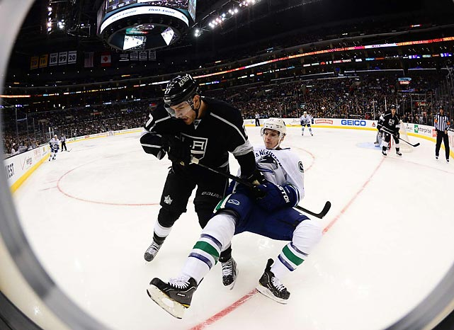 The Los Angeles Kings and the Vancouver Canucks battle for a puck in the corner during their Jan. 28 game. Locked a 2-2 after regulation and overtime, the Kings prevailed when right winger Jeff Carter scored in the shootout.