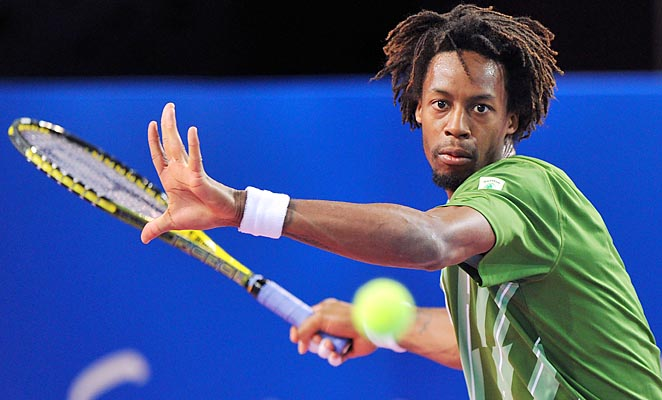 Gael Monfils beat Ruben Bemelmans of Belgium 7-5, 6-4 in his home country to advance.